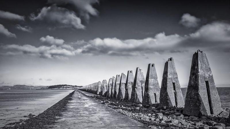 Cramond Island walkway Edinburgh Cramond Cramondisland Scotland Island Shore Sea Seaside Sky Cloudysky Clouds No People Tranquil Scene The Way Forward Sand Beach Outdoors Blackandwhite Stones Stones & Water Landscape Scenics FirthOfForth Pylons Antisubmarine