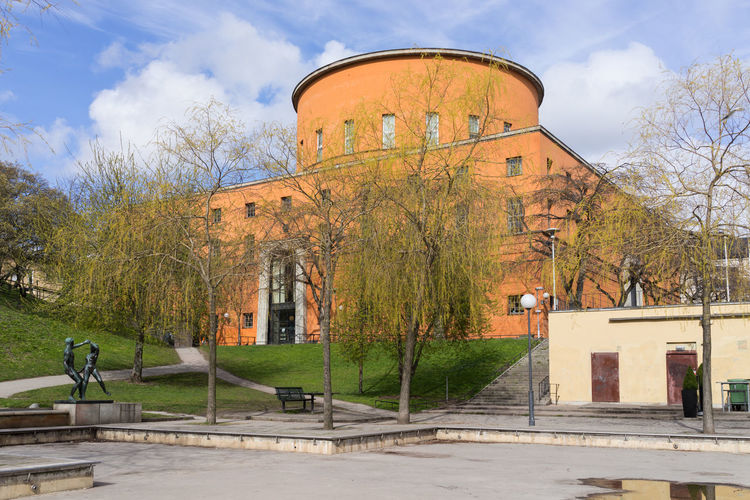 External view of Stockholm Public Library in the early spring in 2016. Architecture Architecture_collection Building Destination Europe Landmark Landmarks Library Nordic Countries Park Scandinavia Stockholm Stockholm, Sweden Sweden Travel Tree
