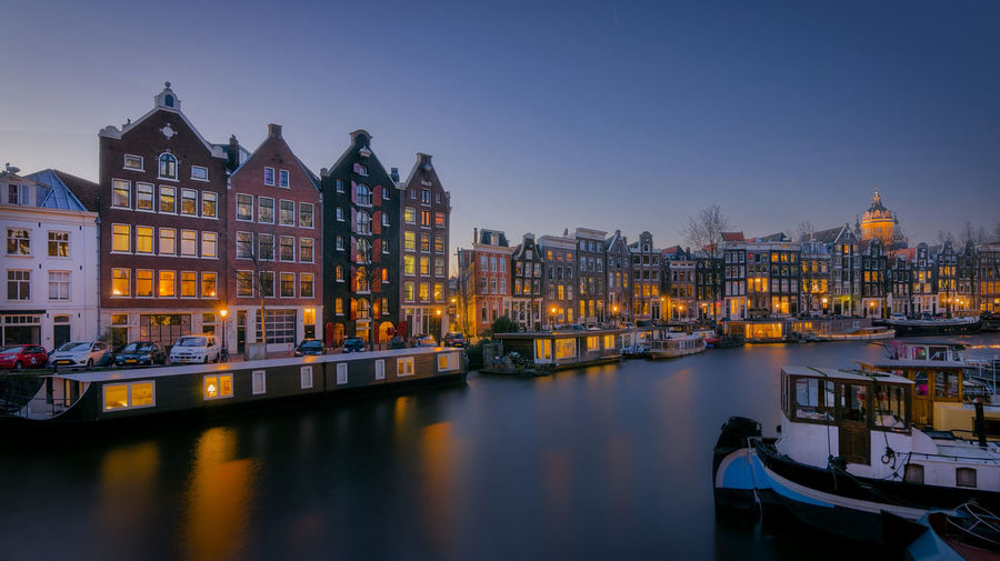 Waalseilandgracht Blue Hour Architecture Building Exterior Built Structure City Cityscape Clear Sky Day Harbor Illuminated Mode Of Transport Moored Nautical Vessel No People Outdoors Reflection Sky Transportation Travel Destinations Water Waterfront