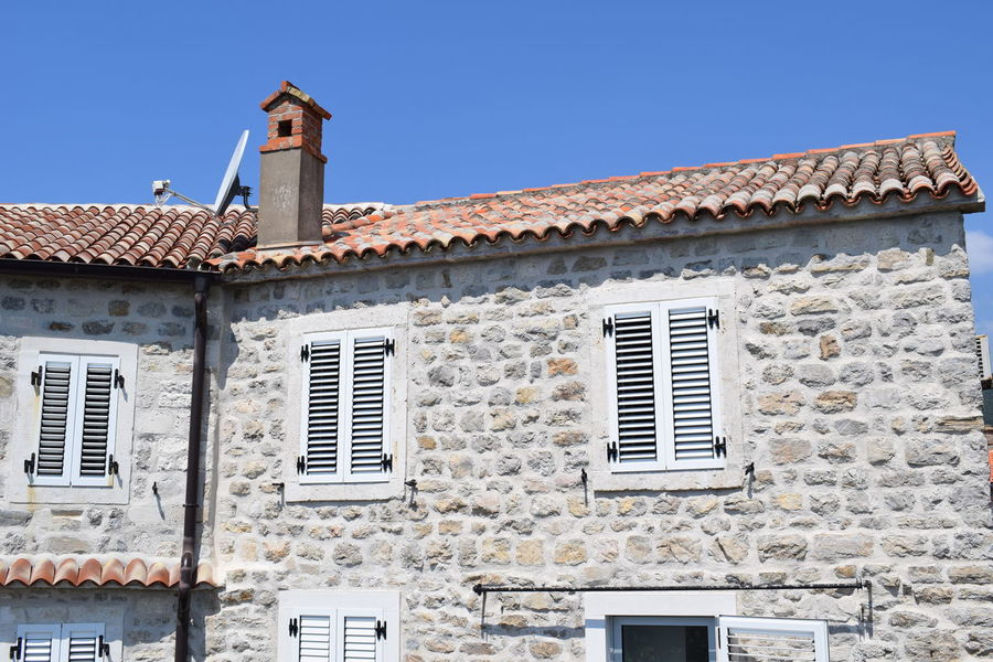 Budva Architecture Blue Brick Budva Old Town Building Building Exterior Built Structure Clear Sky Day House Low Angle View Montenegro Nature No People Old Outdoors Residential District Roof Roof Tile Sky Wall Wall - Building Feature Window