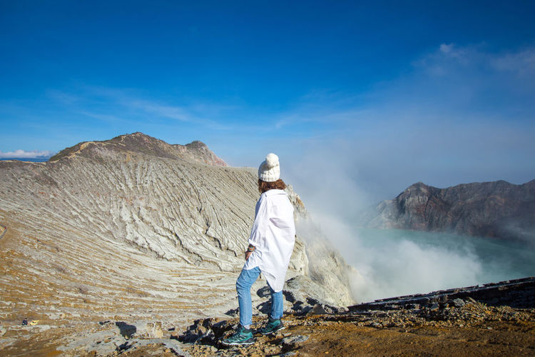 INDONESIA Travel Beauty In Nature Blue Sky Casual Clothing Day Environment Full Length Geology Hot Spring Kawah Ijen Landscape Leisure Activity Lifestyles Men Mountain Nature Non-urban Scene One Person Outdoors Physical Geography Real People Rear View Scenics - Nature Sky Tourism