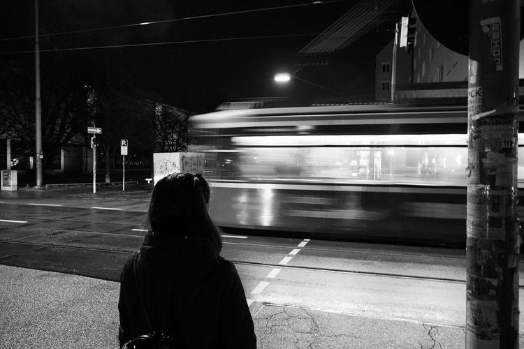 Rear view of train at railroad station at night