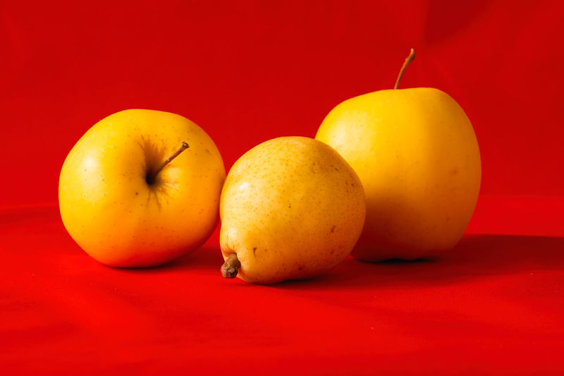 Close-up of oranges against red background