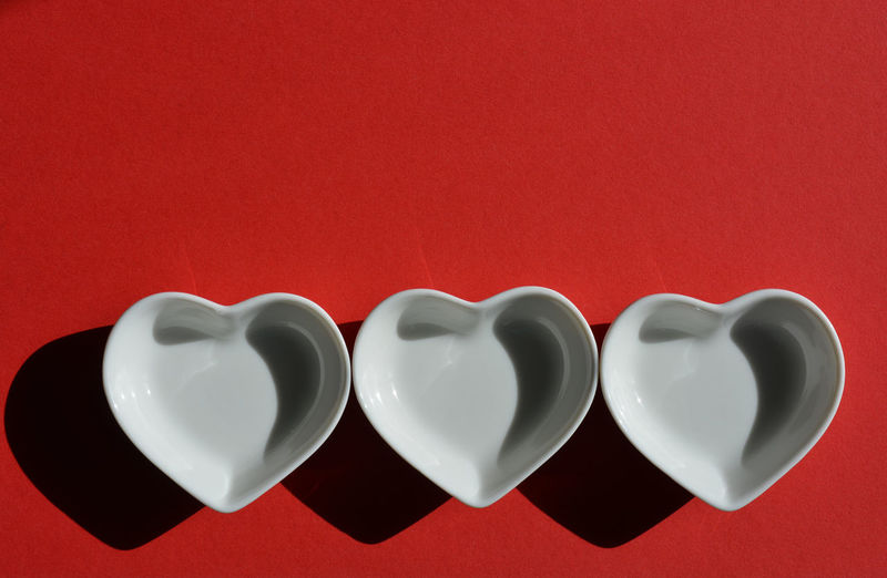 Directly above shot of heart shape over white background