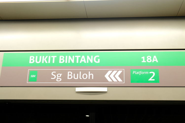 Low angle view of information sign at airport