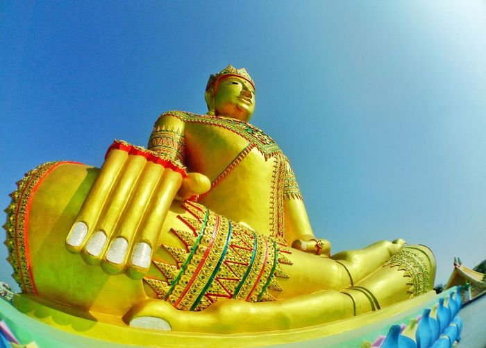 Thai's buddha with blue sky in art of religion Outdoors Travel Tourism Faith Beauty In Art Architecture Buddha Yellow Golden Color Large BIG Religion Worship Blue Sky Sunlight Thailand Sculpture EyeEm Selects Gold Colored Yellow Low Angle View No People Gold Day Sky