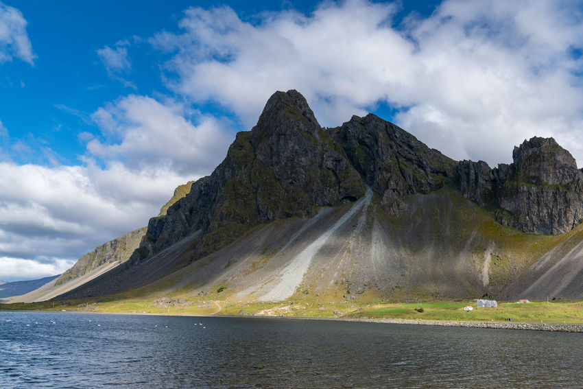 Iceland Beautifuliceland Beauty In Nature Cloud - Sky Day Formation Idyllic Lake Mountain Mountain Peak Mountain Range Nature No People Non-urban Scene Remote Rock Scenics - Nature Sky Tranquil Scene Tranquility Water Waterfront