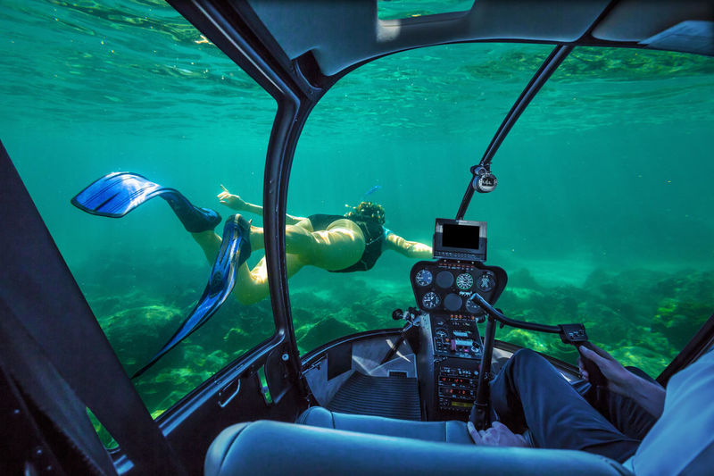 Underwater submarine ship following a young female snorkeling in tropical sea. Woman apnea swims in coral reef with sunbeams. cockpit interior view. Undersea background. Travel concept. Helicopter Flight Window Flying Plane Airplane Aerial View Panorama Console Interior Skyline Cityscape Cockpit Cockpit View Dive Diving Underwater Snorkeling Woman Females Water Sea UnderSea Transportation Mode Of Transportation Swimming Nature One Person Scuba Diving Blue Underwater Diving Day Adventure Animals In The Wild Outdoors Aquarium Animal Themes Nautical Vessel Turquoise Colored Marine