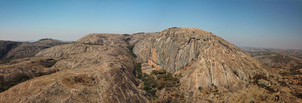 Ngomakurira rock near Harare Zimbabwe Beauty In Nature Clear Sky Landscape Mountain Peak Mountain Range Nature Ngomakurira No People Non-urban Scene Outdoors Remote Rock Rock - Object Rock Formation Tranquil Scene Tranquility