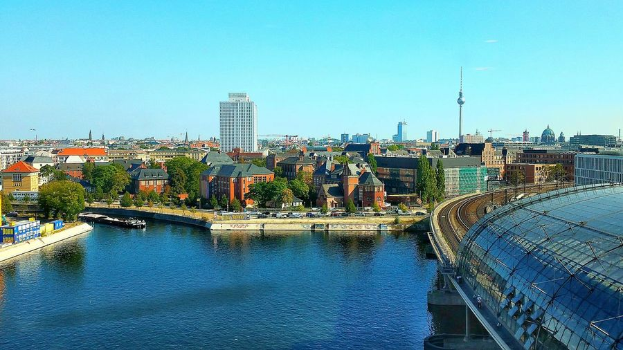 City By River Against Clear Blue Sky
