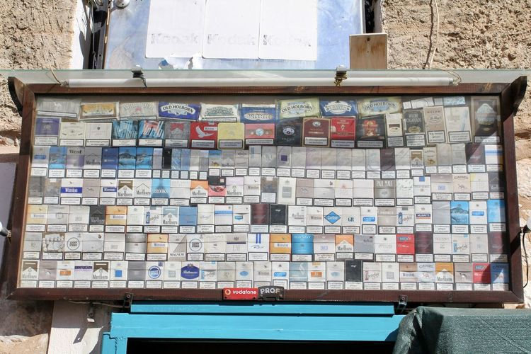 Tobacco Paradise Display Variety Pack Of Cigarettes Collection Areopolis Greece Peloponnese Greece Cigarettes Creativity Outdoors Large Group Of Objects Variation Wall - Building Feature No People Multi Colored Vintage Kiosk Built Structure Mani