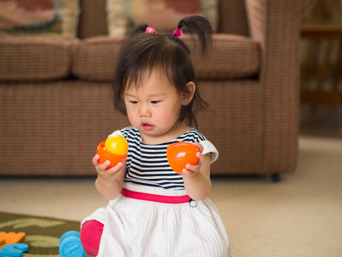 baby girl playing toy at home Asian Baby Girl Building Exterior Child Childhood Day Elementary Age Food Food And Drink Front View Girls Halloween Holding Leisure Activity One Person Outdoors People Playing Real People