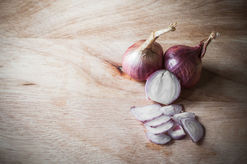 High Angle View Of Onion On Wooden Table