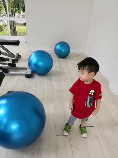 Boy playing with ball at home