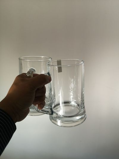 Close-up of hand holding glass of water