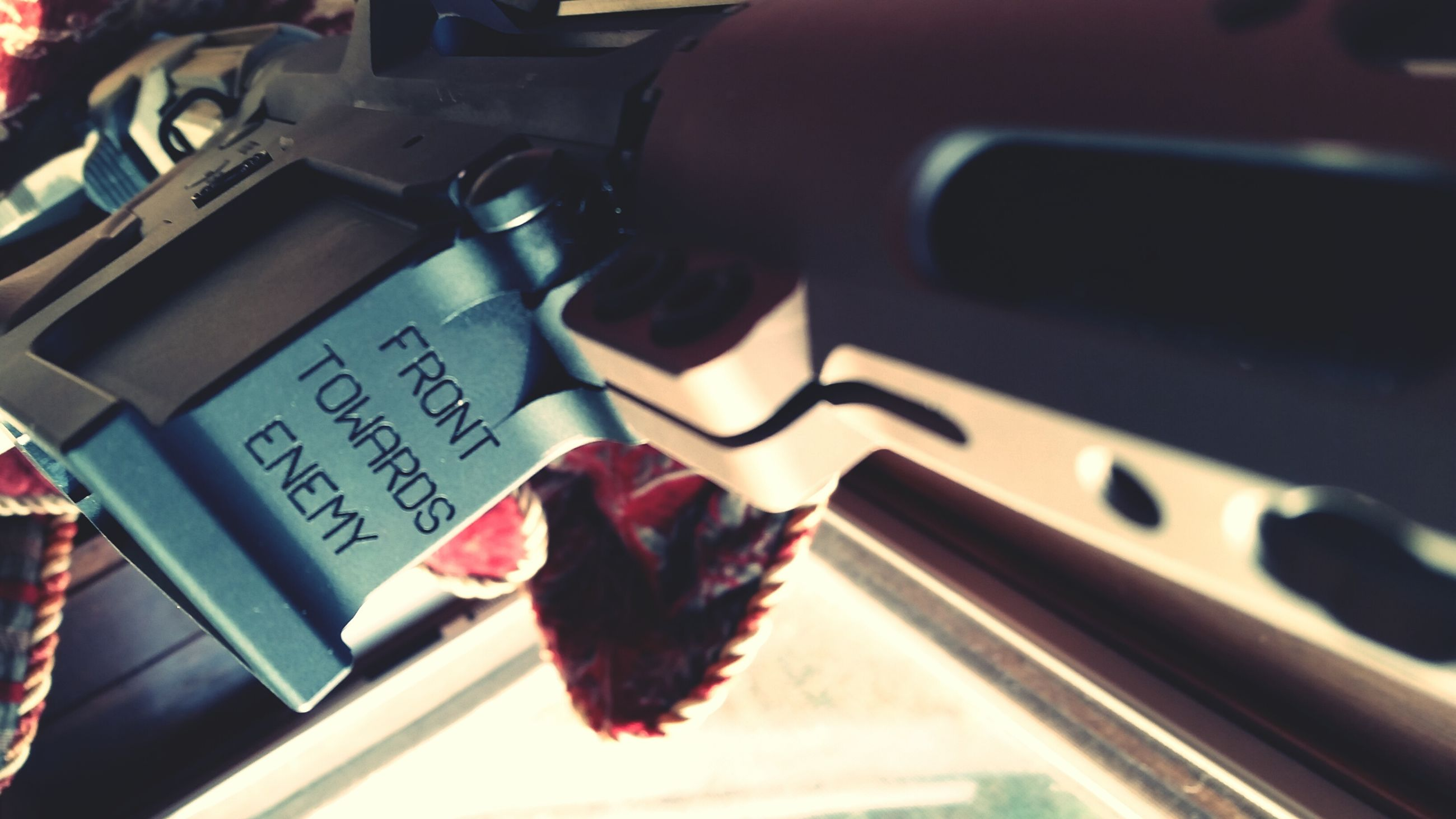indoors, close-up, car, transportation, land vehicle, mode of transport, text, no people, communication, focus on foreground, selective focus, high angle view, western script, part of, still life, red, glass - material, detail, car interior, day