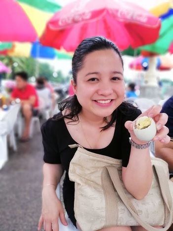 Lady holding balut (Philippine known delicacy) in Boulevard, Dumaguete City Balut Boulevard Dumaguete Philippine Delicacy Adults Only Food Amusement Park People Sweet Food One Young Woman Only Unhealthy Eating Eating Food And Drink Outdoors Holding