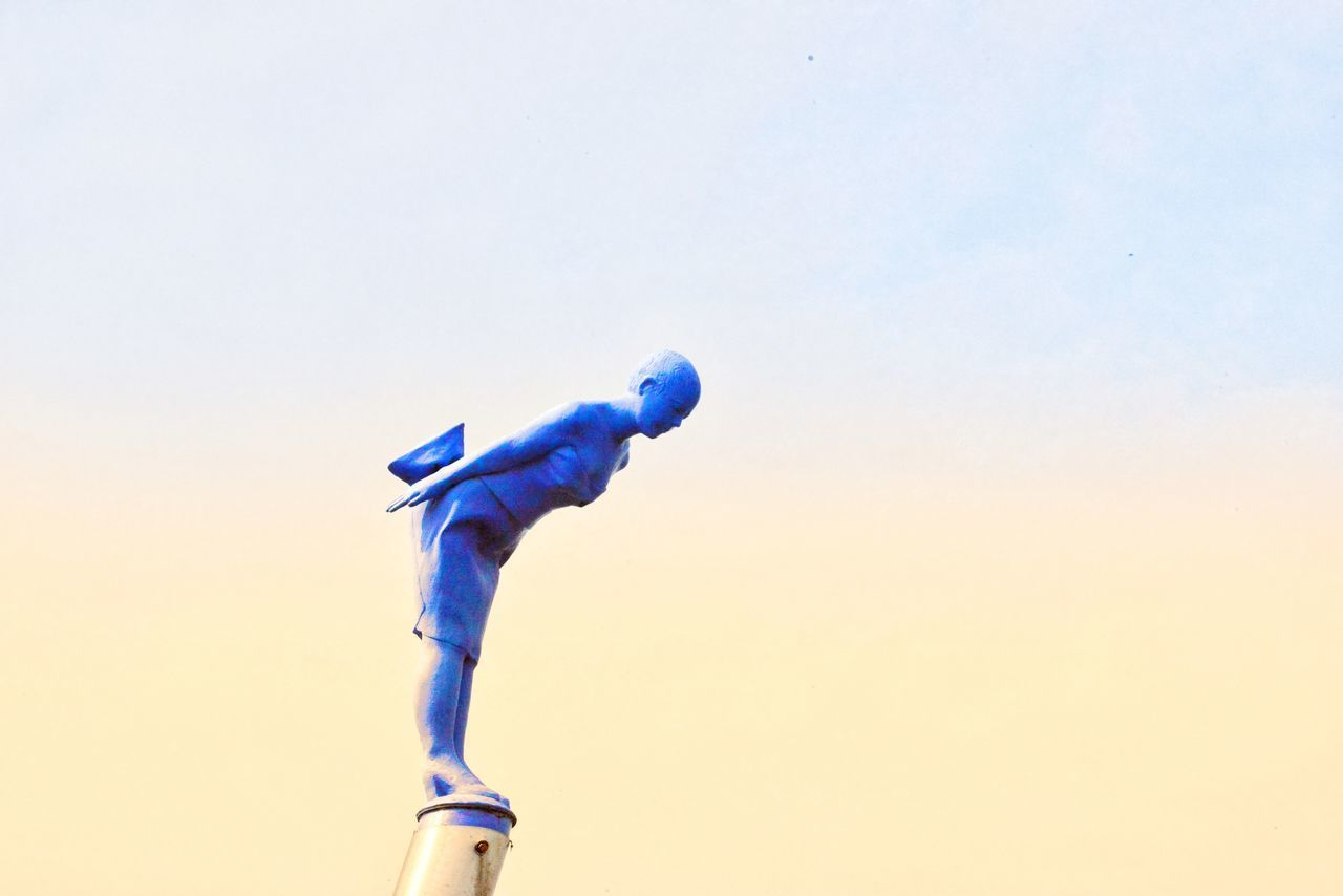 LOW ANGLE VIEW OF BLUE TOY AGAINST SKY