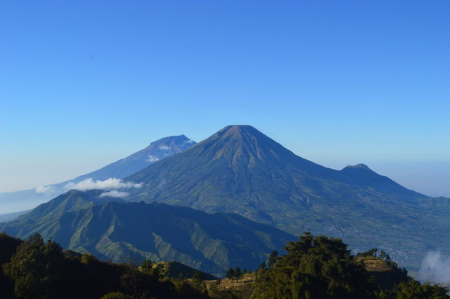 The view of prau mountain Praumountain Landscape_Collection Wonosobo Landscape_photography INDONESIA Indonesia Photography  Beautiful Nature Travel Backpacking Backgrounds Backpacker Sky Blue Sky Beauty In Nature Tree Mountain Clear Sky Forest Volcanic Landscape Mountain Peak Blue Volcano Sky Active Volcano The Traveler - 2018 EyeEm Awards