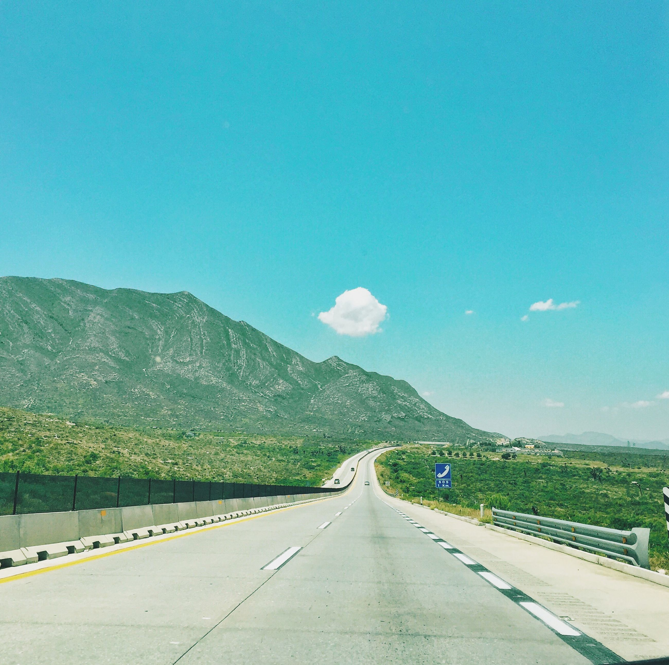 the way forward, road, transportation, diminishing perspective, road marking, mountain, vanishing point, country road, sky, blue, landscape, tranquil scene, empty, empty road, mountain range, asphalt, nature, tranquility, copy space, long