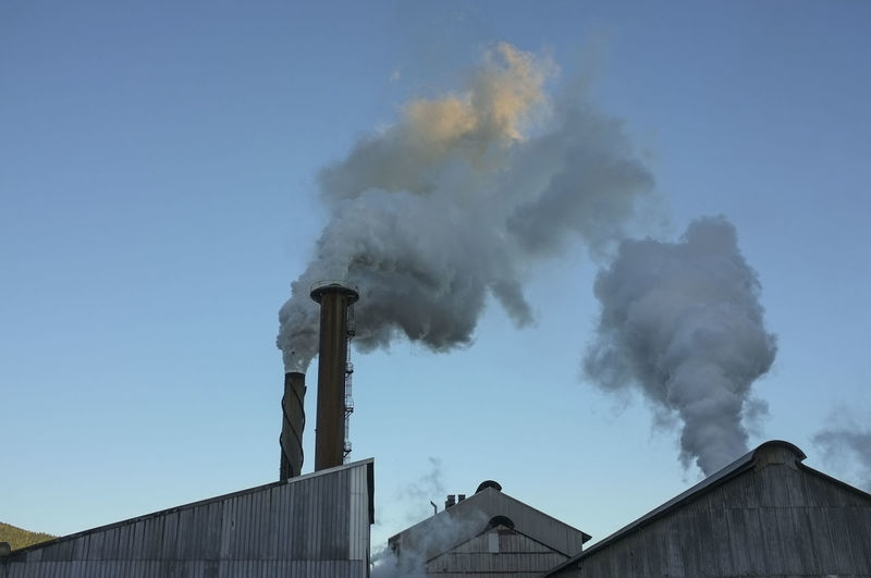 Steam streaming from the Tully Sugar Mill chimneys, in Tully, north Queensland, Australia. Australia Steam Sugar Mill Sugar Mills Chimney Day Emitting Industry No People Queensland Sky Smoke - Physical Structure Smoke Stack Sugar Industry, Tully