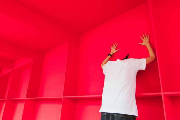 Red Dimension Bright EyeEm Best Shots Architecture Arms Raised Body Part Bold Child Day Hand Hand Raised Human Arm Human Body Part Human Hand Human Limb Indoors  Limb One Person Pink Color Rear View Red Standing Strange Surrealism Three Quarter Length Wall - Building Feature