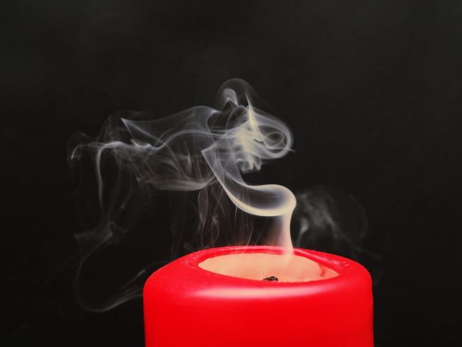 Studio Shot Black Background Indoors  Red Burning Smoke - Physical Structure Candle Flame Close-up Fire No People Heat - Temperature Motion Fire - Natural Phenomenon Copy Space Extinguishing Wax Nature Container Cut Out