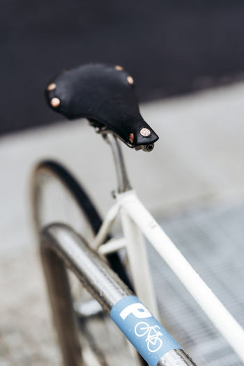 Close-up of bird on bicycle