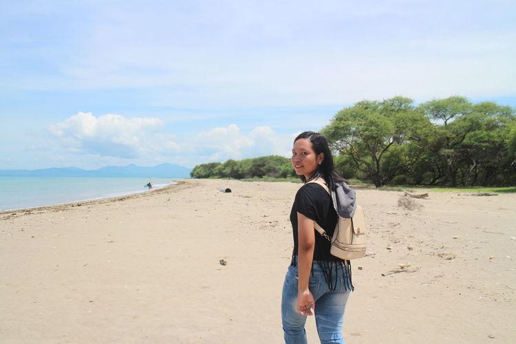 Portrait of woman walking at beach