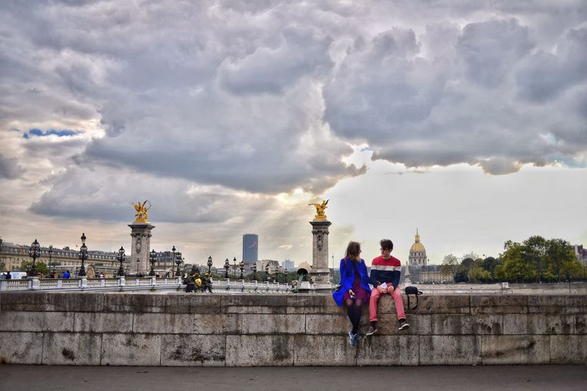 Love is in the air Sky Cloud - Sky Architecture Building Exterior Travel Destinations Real People City Sculpture Two People Togetherness Romance Love Dating Travel Photography Snap a Stranger Paris Paris, France  Love Is In The Air Like A Painting Drawing