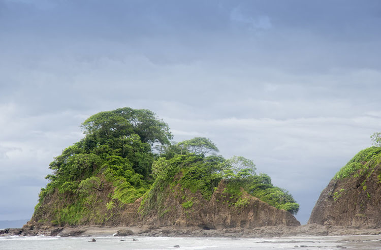 Peninsula with cliffs and tropical trees - Punta Leona, Costa Rica Been There. Costa Rica Overgrown Punta Leona Tree Beach Beauty In Nature Beauty In Nature Cliff Cloud - Sky Nature Outdoors Peninsula People Rock - Object Scenics Sea Tranquil Scene Tranquility Travel Destinations Tree Vacation Water