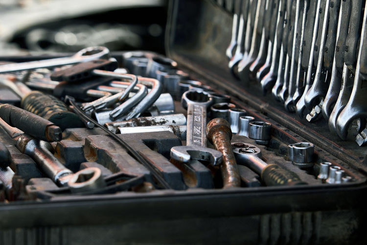 Close-up of tools in container