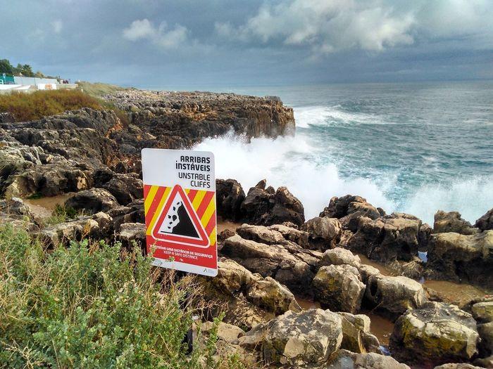 Waves crash near unstable cliffs