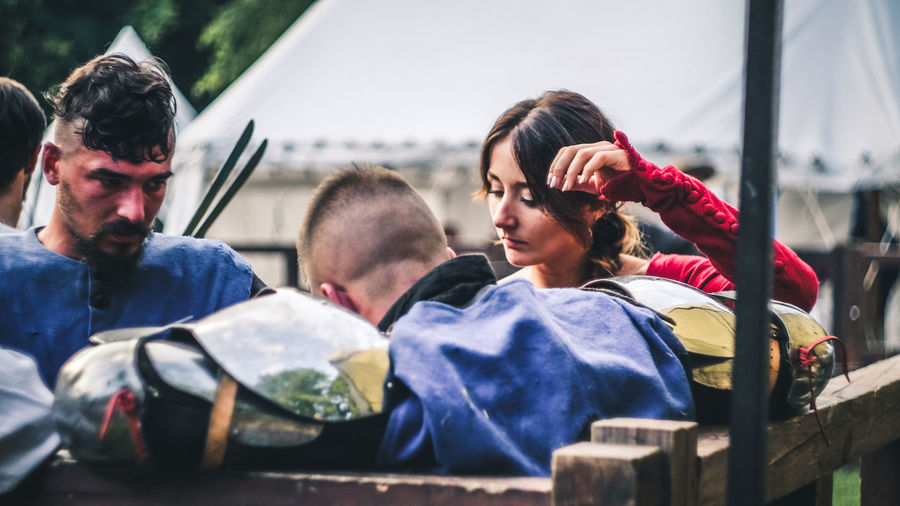 Portrait of young people sitting outdoors