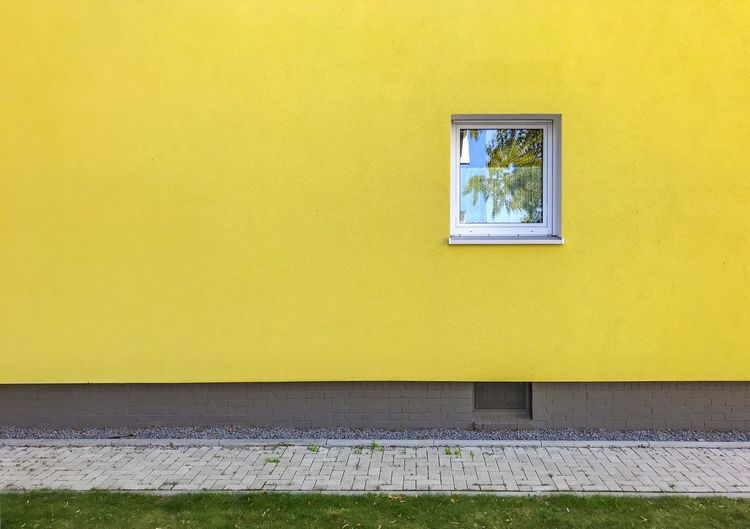 Yellow wall of building