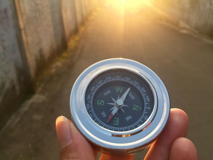 Compass Human Hand Hand Human Body Part Holding Direction Navigational Compass One Person Guidance Human Finger Unrecognizable Person Body Part Day Close-up Discovery Focus On Foreground Exploration Outdoors Sunlight