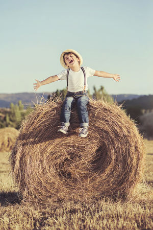 Freedom Fun Funny Grass Happiness Happy Holdays Summertime Bale  Child Childhood Countryside Field Happiness Joy Laugh Lifestyles Nature Outdoors Portrait Rural Scene Smiling Smiling Face Straw Summer