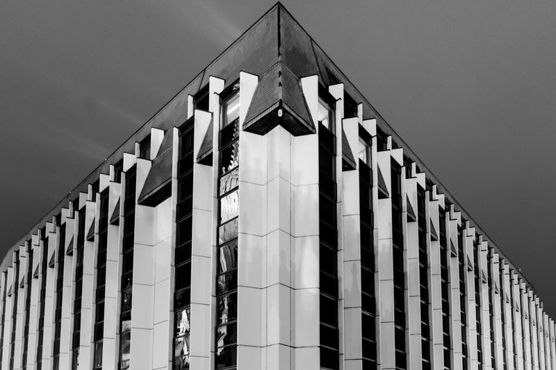 EyeEm Selects Built Structure Architecture Building Exterior Low Angle View Sky Building No People Clear Sky Pattern Outdoors Repetition Shape Glass - Material City Modern 17.62°