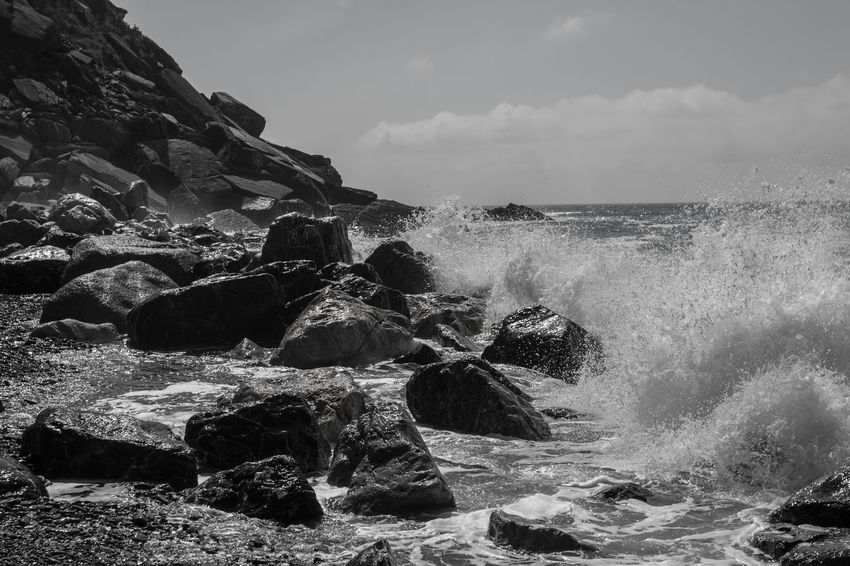 Rocky beach with waves Rock Beach Beach Rock Beach Rocky Beauty In Nature Breaking Day Flowing Water Hitting Horizon Horizon Over Water Land Motion Nature No People Outdoors Power Power In Nature Rock Rock - Object Rocky Coastline Scenics - Nature Sea Sky Solid Splashing Water Wave Waves