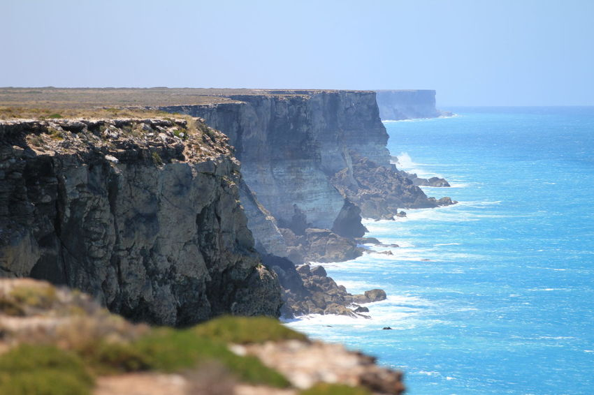 The Bunda cliffs are part of a larger scarp of the Eucla Basin that spreads from the western part of South Australia across to the south eastern corner of Western Australia Beauty In Nature Clear Sky Cliff Day Great Australian Bight Horizon Over Water Nature No People Outdoors Rock - Object Rock Formation Scenics Sea Sky South Australia Tranquility Water