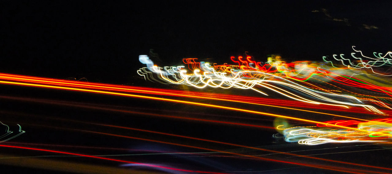 Great shot on a highway with slow shutter speed and car zooming past Abstract Blurred Motion Car City Fastlights Highway Illuminated Light Effect Light Trail Long Exposure Motion Moving Lights Multi Colored Night On The Move Outdoors Road Slowshutter Slowshutterspeed Speed Streaming Lights Street Tail Light Traffic Transportation