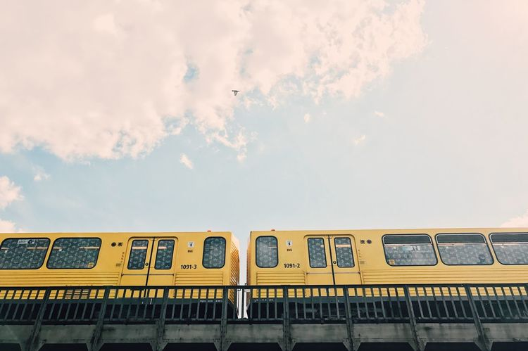 Paint The Town Yellow Architecture Building Exterior Built Structure Cloud - Sky Commuter Train Day Mode Of Transport No People Outdoors Passenger Train Public Transportation Rail Transportation Sky Text Train - Vehicle Transportation