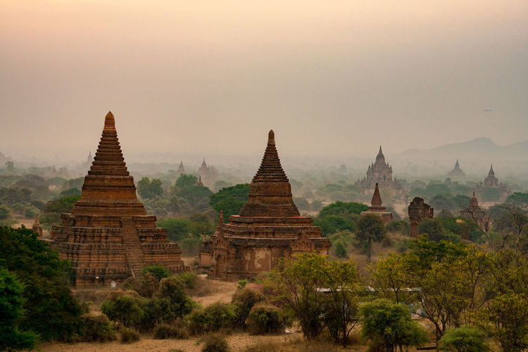 Landscape stupa in Bagan Mandalay Myanmar Religion Built Structure Belief Architecture Place Of Worship Travel Destinations History Sky The Past Spirituality Plant Ancient Nature Travel Ancient Civilization No People Building Exterior Fog Outdoors Archaeology Spire  Myanmar Bag Stupa Astronomy Tourism Burma The Traveler - 2019 EyeEm Awards