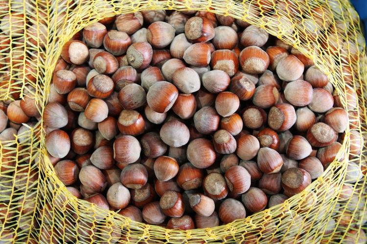 Directly above shot of chestnuts in basket at market