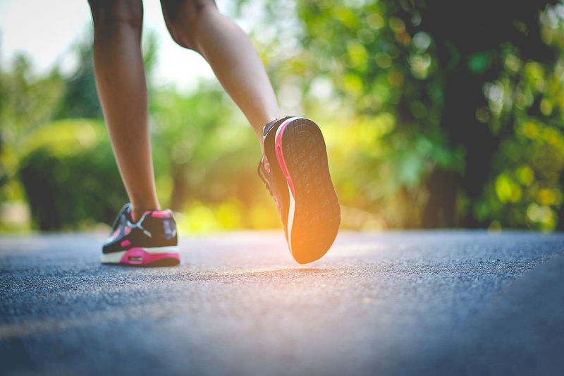 Body Part Day Exercising Healthy Lifestyle Human Body Part Human Foot Human Leg Human Limb Leisure Activity Lifestyles Limb Low Section One Person Outdoors Real People Running Selective Focus Shoe Sole Of Shoe Sport Sports Training Surface Level Women