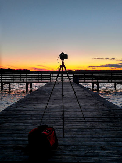 DSLR Sunset_collection Beauty In Nature Camera - Photographic Equipment Clear Sky Day Hobby Nature No People Orange Color Outdoors Photography Themes Scenics Sea Silhouette Sky Sunset Tranquility Tripod Water