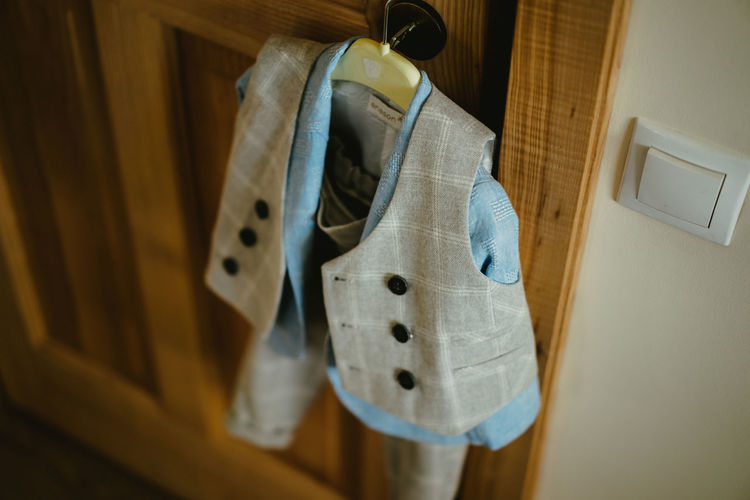 Close-up of clothes hanging on wood at home