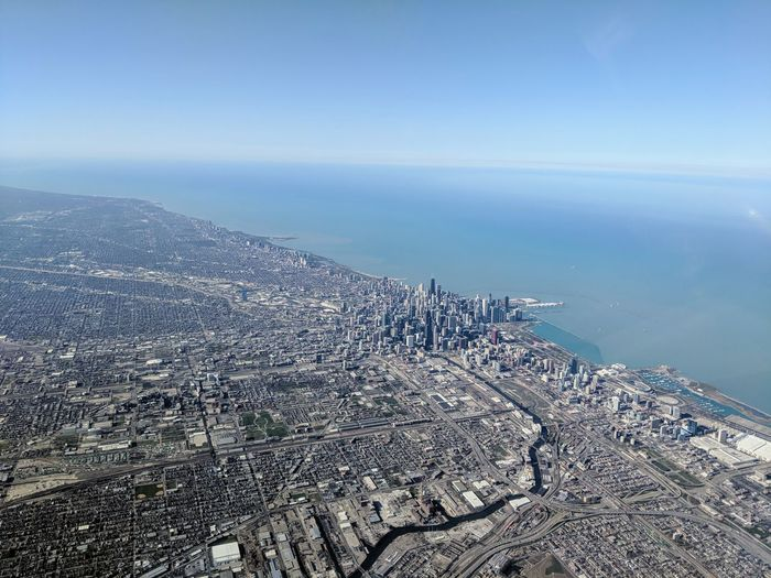 High angle view of chicago city skyline by sea against sky