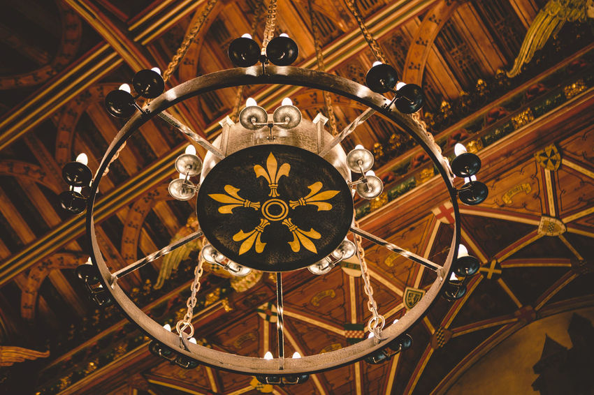 Interesting chandelier inside of Cardiff Castle. Antique Cardiff Castle Chandelier Fleur De Lis Fleur De Lys Fleur-de-lis Gold Colored Medieval