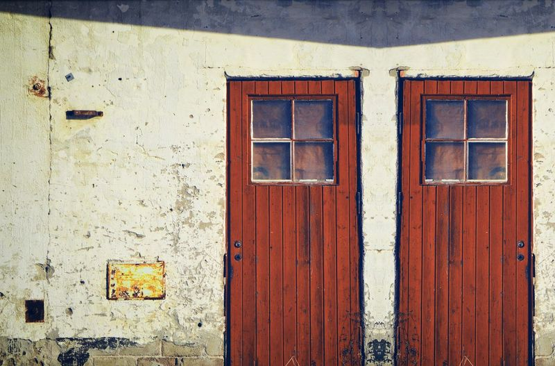 Old garage. Shadow Old Buildings Glass - Material Decaying Building Street Photography Garage Building Exterior Window Architecture Built Structure Building No People Day Door Old Entrance Wood - Material Closed Wall - Building Feature Run-down Weathered Outdoors Abandoned Damaged My Best Photo The Architect - 2019 EyeEm Awards
